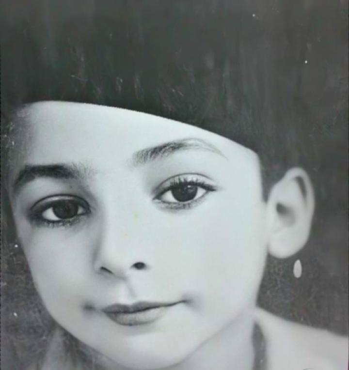 Click to enlarge image rochdi abaza child.png